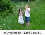 a boy with a girl playing in a... | Shutterstock . vector #1355915150