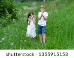 a boy with a girl playing in a... | Shutterstock . vector #1355915153