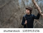 portrait of a boy in a coat and ... | Shutterstock . vector #1355915156