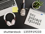Small photo of top view of podcast recording equipment on desk with words new podcast episode written on note pad