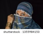 arab lady from afghanistan with ... | Shutterstock . vector #1355984153