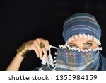 arab lady from afghanistan with ... | Shutterstock . vector #1355984159
