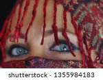 arab lady from afghanistan with ... | Shutterstock . vector #1355984183