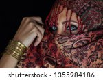 arab lady from afghanistan with ... | Shutterstock . vector #1355984186