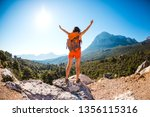 the girl at the top of the... | Shutterstock . vector #1356115316