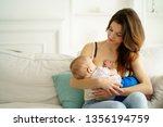 breastfeed  motherhood  mothers ...   Shutterstock . vector #1356194759