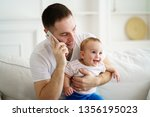 young father teleworking ... | Shutterstock . vector #1356195023
