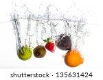 a lemon  kiwi  strawberry ... | Shutterstock . vector #135631424