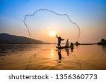 Asia Fisherman Net Using On...
