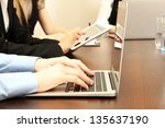 male hands with laptop on... | Shutterstock . vector #135637190