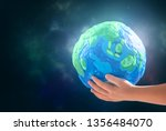 child holding planet in hands... | Shutterstock . vector #1356484070