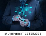 businessman hand use smart... | Shutterstock . vector #135653336