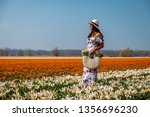 woman with dress and flowers... | Shutterstock . vector #1356696230