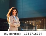 young business woman posing... | Shutterstock . vector #1356716339