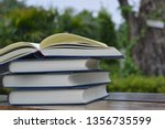 the stack of books is placed on ... | Shutterstock . vector #1356735599