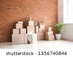moving boxes near brick wall in ... | Shutterstock . vector #1356740846