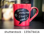 red ceramic cup with good... | Shutterstock . vector #135676616