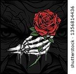 skull hand holding a rose.hand... | Shutterstock .eps vector #1356814436