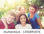 portrait of smiling children | Shutterstock . vector #1356892076