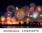 fireworks at the lake during... | Shutterstock . vector #1356916970