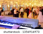 dancing couples during party... | Shutterstock . vector #1356916973