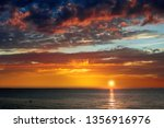 sunset on the sea with... | Shutterstock . vector #1356916976