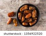 dates in black bowl on wooden...   Shutterstock . vector #1356922520