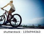 woman cyclist riding mountain... | Shutterstock . vector #1356944363