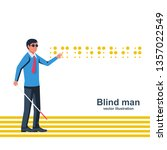 blind man with a white cane on... | Shutterstock .eps vector #1357022549