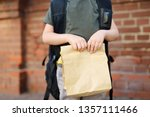 student with big backpack and... | Shutterstock . vector #1357111466