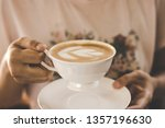 female hands holding coffee... | Shutterstock . vector #1357196630