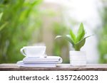 white coffee cup and notebooks...   Shutterstock . vector #1357260023