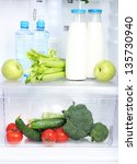 open refrigerator with... | Shutterstock . vector #135730940