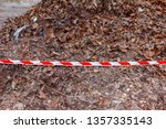 red and white striped barrier... | Shutterstock . vector #1357335143