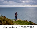 woman on the edge of a cliff... | Shutterstock . vector #1357337186
