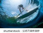 underwater view of the surfer...   Shutterstock . vector #1357389389