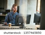 office worker on his computer.... | Shutterstock . vector #1357465850