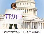 protester boy child holding... | Shutterstock . vector #1357493600