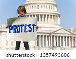 boy manifesting holding sign... | Shutterstock . vector #1357493606