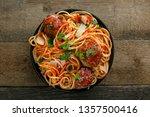pasta with meatballs  parmesan...   Shutterstock . vector #1357500416