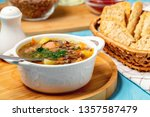 lentil soup with chicken in a... | Shutterstock . vector #1357587479