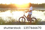 the boy is riding a bicycle... | Shutterstock . vector #1357666670