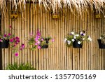 flower on the bamboo wall... | Shutterstock . vector #1357705169
