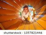 happy child girl playing in... | Shutterstock . vector #1357821446