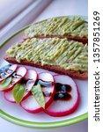 sliced radish and guacamole... | Shutterstock . vector #1357851269