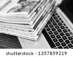 newspapers and laptop. pile of... | Shutterstock . vector #1357859219