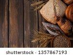 fresh bread on wooden surface | Shutterstock . vector #1357867193