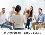 people sitting and raising... | Shutterstock . vector #1357911683