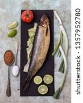 Stock photo  egyptian smoked herring fish with green onion lemon tomatoes spices 1357952780