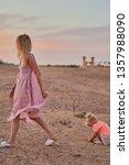 deserted beauty. girl  mother... | Shutterstock . vector #1357988090